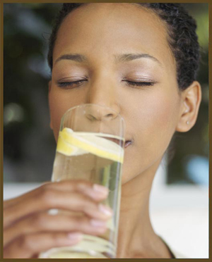 Washington DC Dermatology - Woman Drinking Lemon